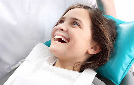 Smiling Child in a Dental Chair